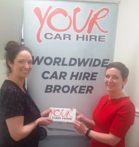 Norma Tolefe (WTC) receiving her prize from Jo-Ann Raleigh (ASM - GSA for Your Car Hire)