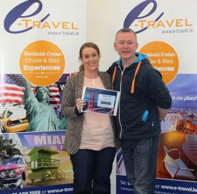 Colette McNally (eTravel) receives her prize from Frank McCaffrey (KLM)