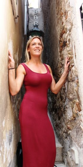 Svelte Anne Marie Last (Cassidy Travel) demonstrates how narrow this Taormina alleyway is.
