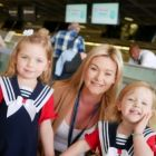 Nicola Callaghan (Thomson Cabin Crew) with Juliette and Sophia Cullen at the Thomson check-in counter