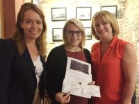 Laura Burke receiving her prize from Caitriona Toner (American Airlines) and Tara Magee (British Airways)
