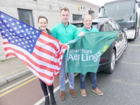 Team Aer Lingus wave the flags en route to Belfast