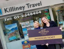 Elaine Massey receiving her tickets form Shannon O'Dowd (Etihad)