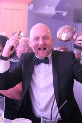 Jason Whelan (Blue Insurance) is pictured with the Blue Insurance Best Travel Insurance Company 2018 award.