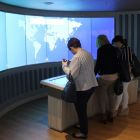 Checking out the interactive touch screens
