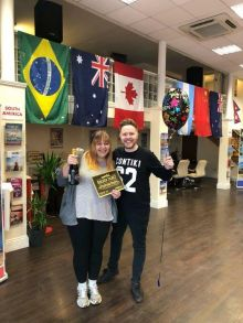 Kelsey Burrows receiving her 'Golden Ticket' from James Lavin (Sales Manager Contiki)