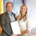 Nearest the Pin Winner Paul Dawson (Dawson Travel) receives his prize from Holly Best (Virgin Atlantic)