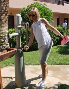 Linda Magill (Cassidy Travel) pumping the well