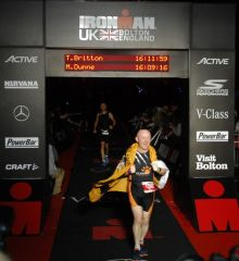 Tom Britton crosses the line