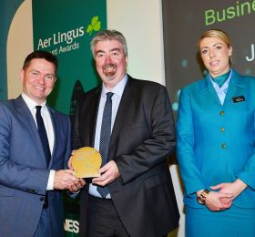 Declan Kearney (Head of Communications Aer Lingus) presents Business Person of the Year  to John Toner (WIS Group)