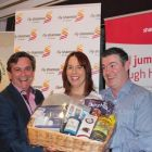 Declan Power & Isabel Harrison presenting Paul Sexton with his winning prize