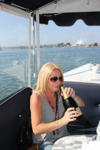 Lorraine Crowley (Shandon Travel) swigs a bottle of champers as there were no glasses on board the boat!