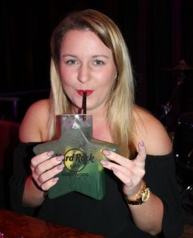 Regina Curran (Club Travel) tastes a special Hollywood cocktail.