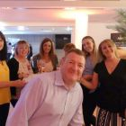 Mark takes centre stage with the Abbey Travel Dublin Team.