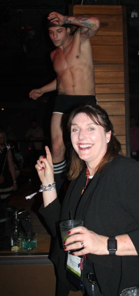 Dee Burdock (Visit USA Committee Ireland) enjoying the male dancer at the Destination DC and NYC & Company LGBTQ event